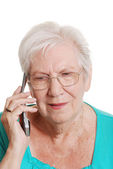 Senior woman talking on a cell phone — Stock Photo
