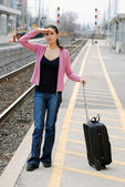 Woman looking for the train — Stock Photo