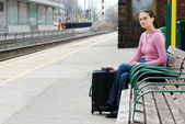 Woman waiting at the train station — Stock Photo