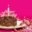 Stock Photo: Close up of a chocolate birthday cake with decorations