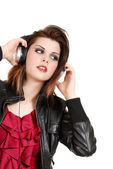 Brunette woman listening to music with headphones — Stock Photo