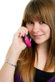Cute female teenager on a cell phone — Stock Photo