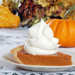 Whip cream loaded on pumpkin pie — Stock Photo