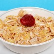 Closeup of bowl of flaky cereal with strawberry — Stok Fotoğraf #3444090