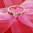 Diamond ring on pink bow — Foto Stock
