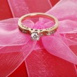 Diamond ring on pink bow — Stock Photo #3444122
