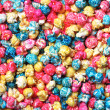 Colorful candy popcorn making a background — Photo