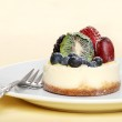 Fruit cheesecake with a fork — Stock Photo #3444449