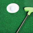 Stock Photo: Golf ball in the cup with putter