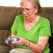 Grandmother Playing Video Game - Stock Photo