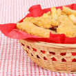 Chicken fingers and french fries in a basket — Stock Photo