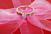 Diamond ring on pink bow — Stock Photo