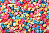 Colorful candy popcorn making a background — Stock Photo