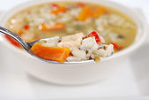 Macro spoonful chicken and wild rice soup — Stock Photo