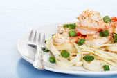 Shrimp with noodles and fork — Stock Photo