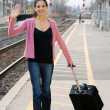 Royalty-Free Stock Photo: Woman waving at train station