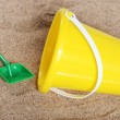 Yellow childs pail in the sand — Stock Photo
