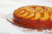 Upside down pear cake on glass plate — Stock Photo