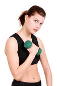 Young woman with green free weight — Stock Photo