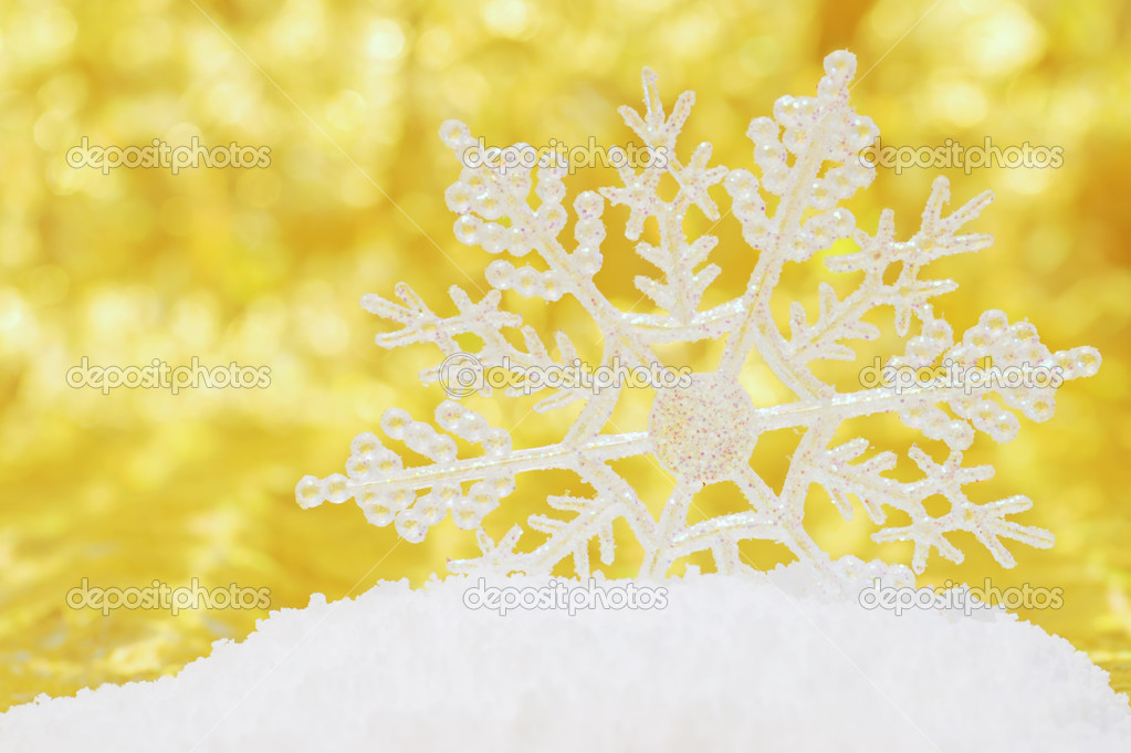Gold Snowflake Background Snowflake in snow with gold