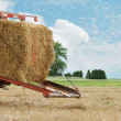 Stock Photo: Closeup of a hay baler