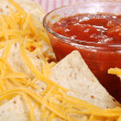 Macro nachos and cheese with salsa - Stock Photo
