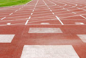Outdoor sports track focus on numbers — Stock Photo