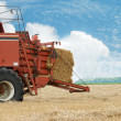Stock Photo: Hay baler in the field