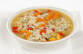 Bowl of chicken and wild rice soup with vegetables — Stock Photo