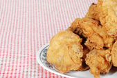 Closeup fried chicken on a plate — Stock Photo