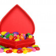 Lots of jelly beans in a red heart box — Stock Photo #3774416