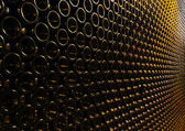 Lots of wine bottles stacked — Stock Photo