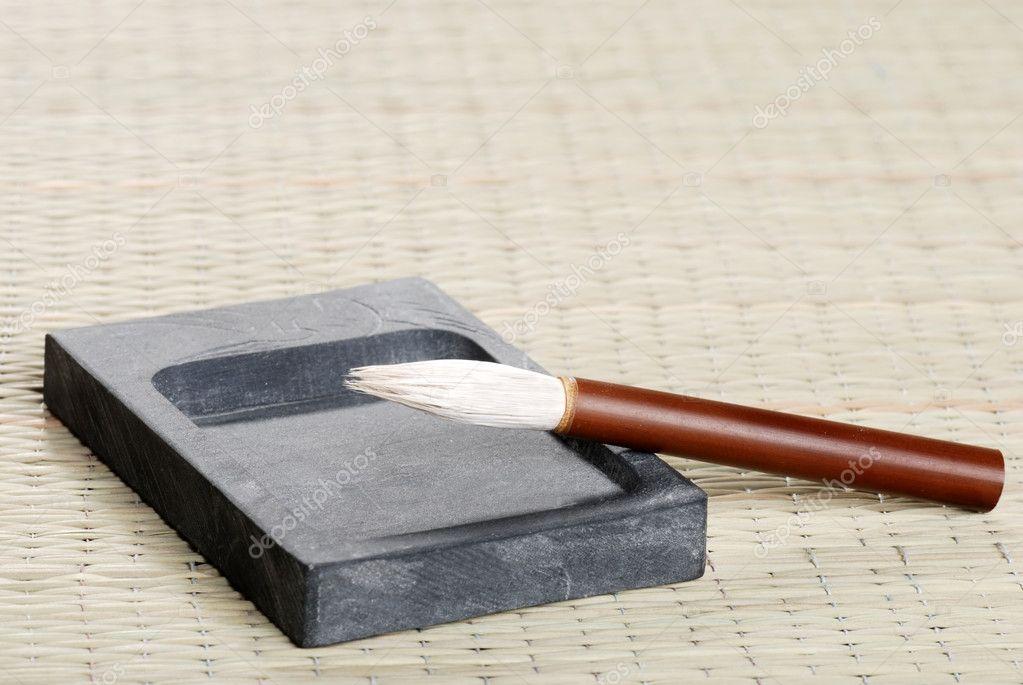 Ink stone and calligraphy brush — stock photo mcgphoto