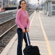 Woman at the train station — Stock Photo