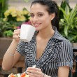 Woman having lunch in outdoor cafe — Stock Photo