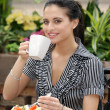 Woman having lunch in outdoor cafe — Stock Photo #3806417