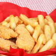 Closeup chicken fingers and french fries — Stock Photo
