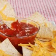 Stock Photo: Dipping nachos in salsa