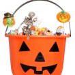 Halloween pumpkin pail filled with candy — Stock Photo