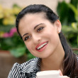 Happy spanish woman drinking coffee — Stock Photo