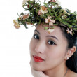 Oriental woman wearing a flower crown — Stock Photo #3807413