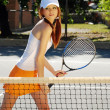 Young woman ready for tennis action — Stock Photo