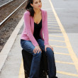 Young woman waiting for the train — Stock Photo