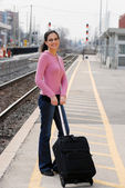 Woman at the train station — Foto Stock