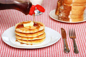 Maple Syrup being poured on a stack of pancakes — Stock Photo