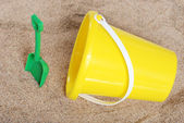 Pail and shovel in the sand — Stock Photo
