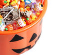 Top view halloween pumpkin pail with candy — Stok fotoğraf
