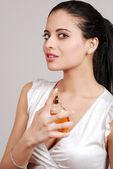 Young woman spraying perfume — Stock Photo
