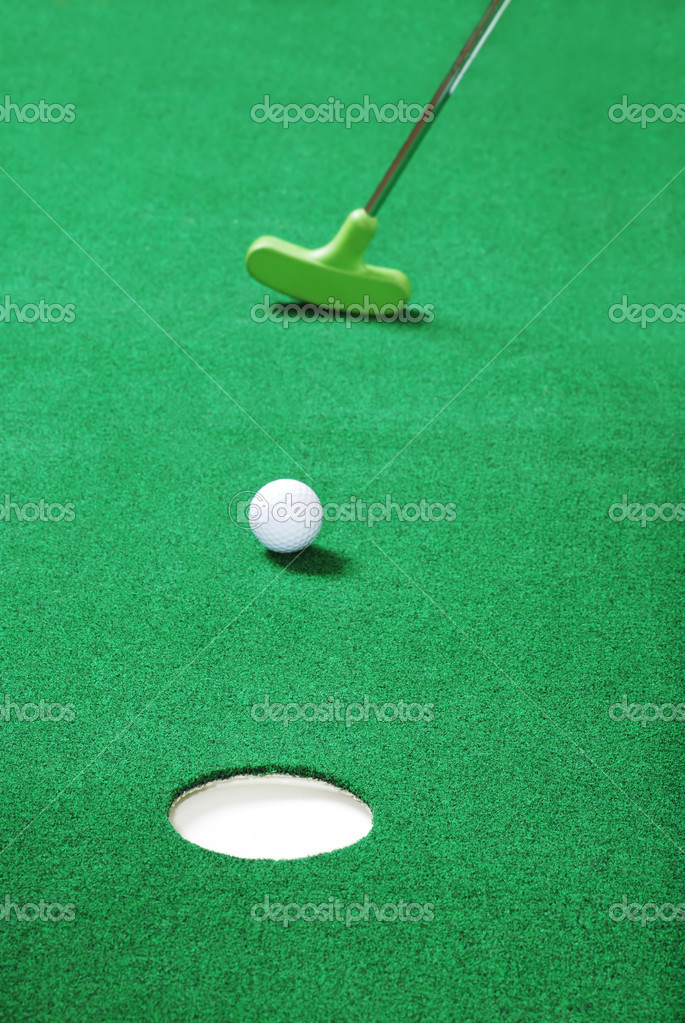Practice putting on fake green grass  — Stock Photo #3807471