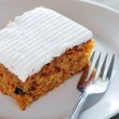 Carrot cake on a plate with fork — Stock Photo